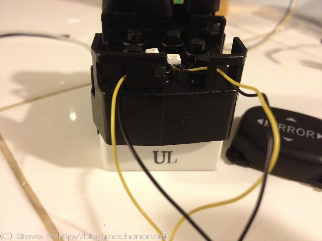 Route the wires through an available opening and reassemble the JDM mirror switch: