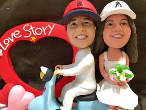 Our custom bobble head dolls ready to top our wedding cake