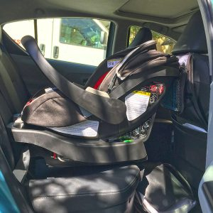 Recaro Performance Coupe infant car seat installed in a 2012 Prius c 4, side view