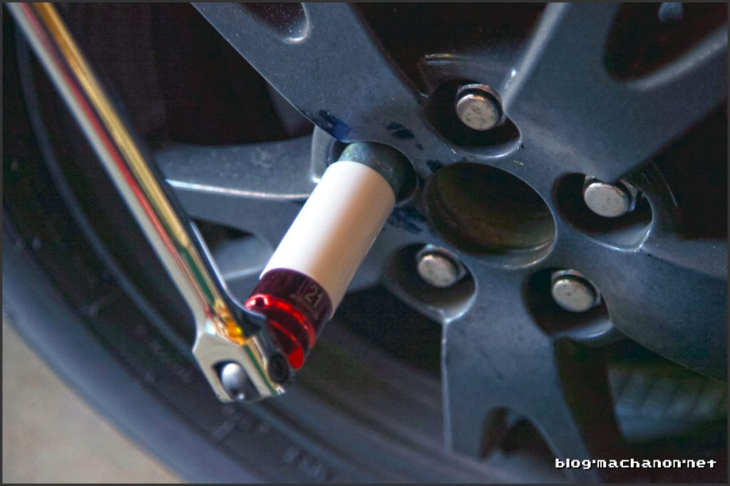 Use a breaker bar to remove the lug nuts.